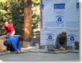 Downtown Rotary installing entrance pavers